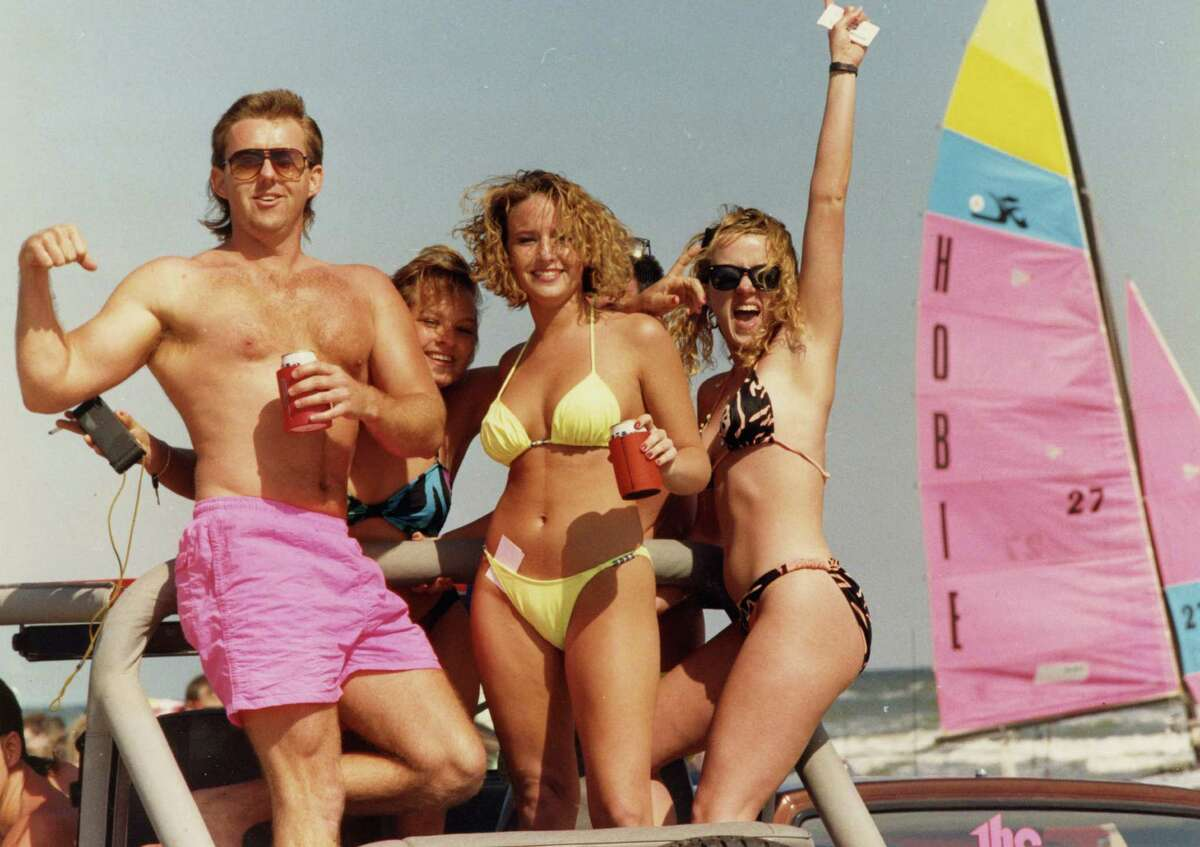 Unidentified revelers onGalveston'sWest Beach ride in the back of a pickup on a sunny, but brisk Sunday on the first weekend of Spring Break. March 10, 1991.