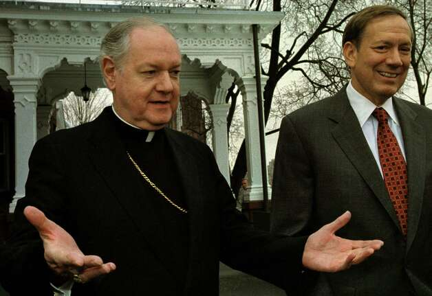 Times Union Staff Photo by Michael P. Farrell--Edward Cardinal Egan Archbishop of New York  (left )  and Govornor George Pataki  greet the press outside the Governor's Mansion prior to a closed doors meeting  in Albany, N.Y. Tuesday March 13, 2001. Cardinal Egan was in town for the New York State Catholic Convention and to meet with Governor George Pataki and other State Law Makers about pending legislation. Photo: MICHAEL P. FARRELL / ALBANY TIMES UNION