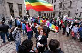 Amanda Keller holds a flag in Linn Park in Birmingham, Ala., at a rally last month in support of same-sex marriage.