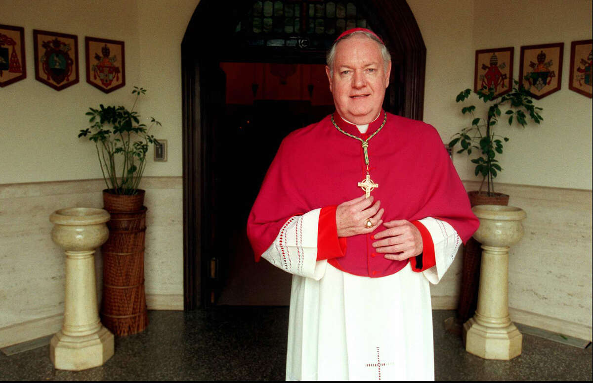 Bishop Edward Egan, head of the Bridgeport diocese, stands in the entrance to St. Augustine Church, Bridgeport in 1997.