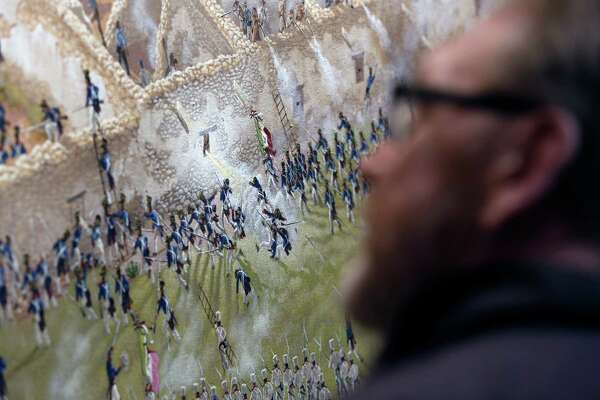 A person looks at a detail is seen Thursday Match 5, 2015 of artist Mark Lemon, one of the leading modern artists whose works focus on the Alamo mission and battle site, titled ÒThe Storming of the Alamo, March 6, 1836,Ó said to be the largest, most historically accurate detailed painting of the battle, at 8 feet tall and 15 feet wide. Lemon said it took him about 3,500 hours over 14 months to do the work.