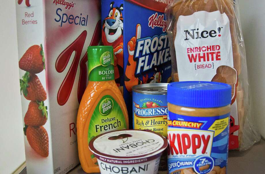 Foods that might have added sugar or another sweetener like high-fructose corn syrup as an ingredient are pictured Wednesday, March 4, 2015, in New York. New guidelines published by the World Health Organization on Wednesday say the world is eating too much sugar and people should slash their sugar intake to just 5 to 10 percent of their overall calories. Photo: Bebeto Matthews, AP / AP