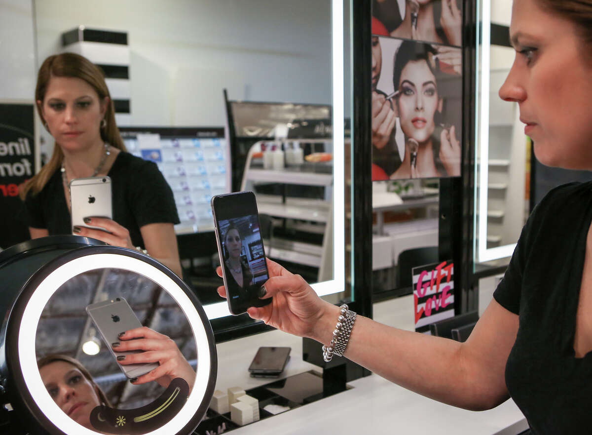 Johnna Marcus, senior director for Sephora Innovation Lab, demonstrates how the company's new tech product works.