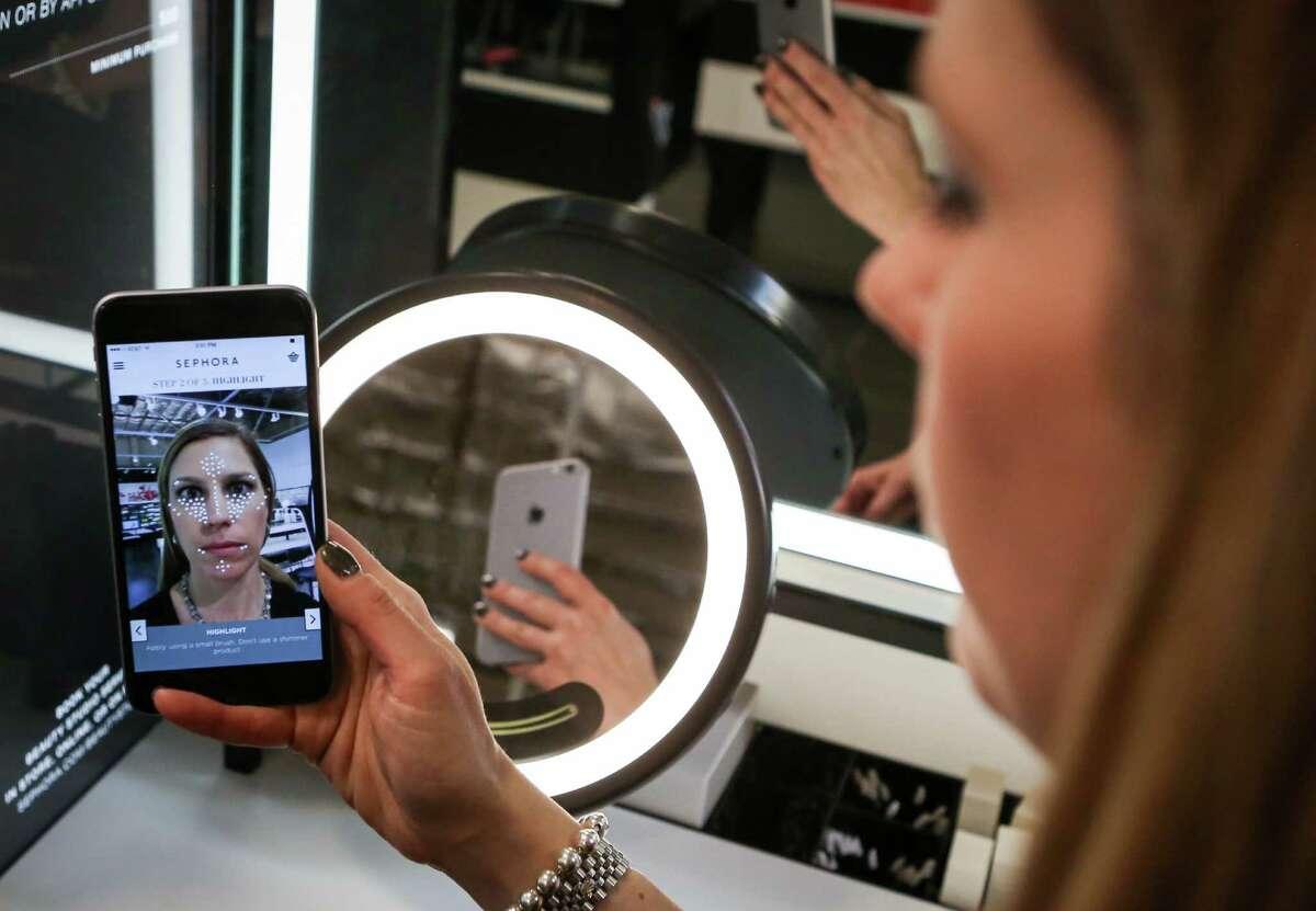 Johnna Marcus, senior director for Sephora Innovation Lab, demonstrates the Sephora's Pocket Contour Class technology.