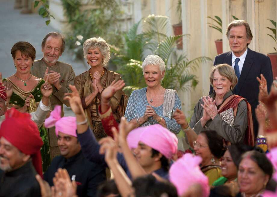 "This image released by Fox Searchlight Films shows, from left, Celia Imrie, Ronald Pickup, Diana Hardcastle, Judi Dench, Maggie Smith and Bill Nighy in a scene from ""The Second Best Exotic Marigold Hotel."" (AP Photo/Fox Searchlight Films, Laurie Sparham) ORG XMIT: NYET123 Photo: Laurie Sparham / Fox Searchlight Films"