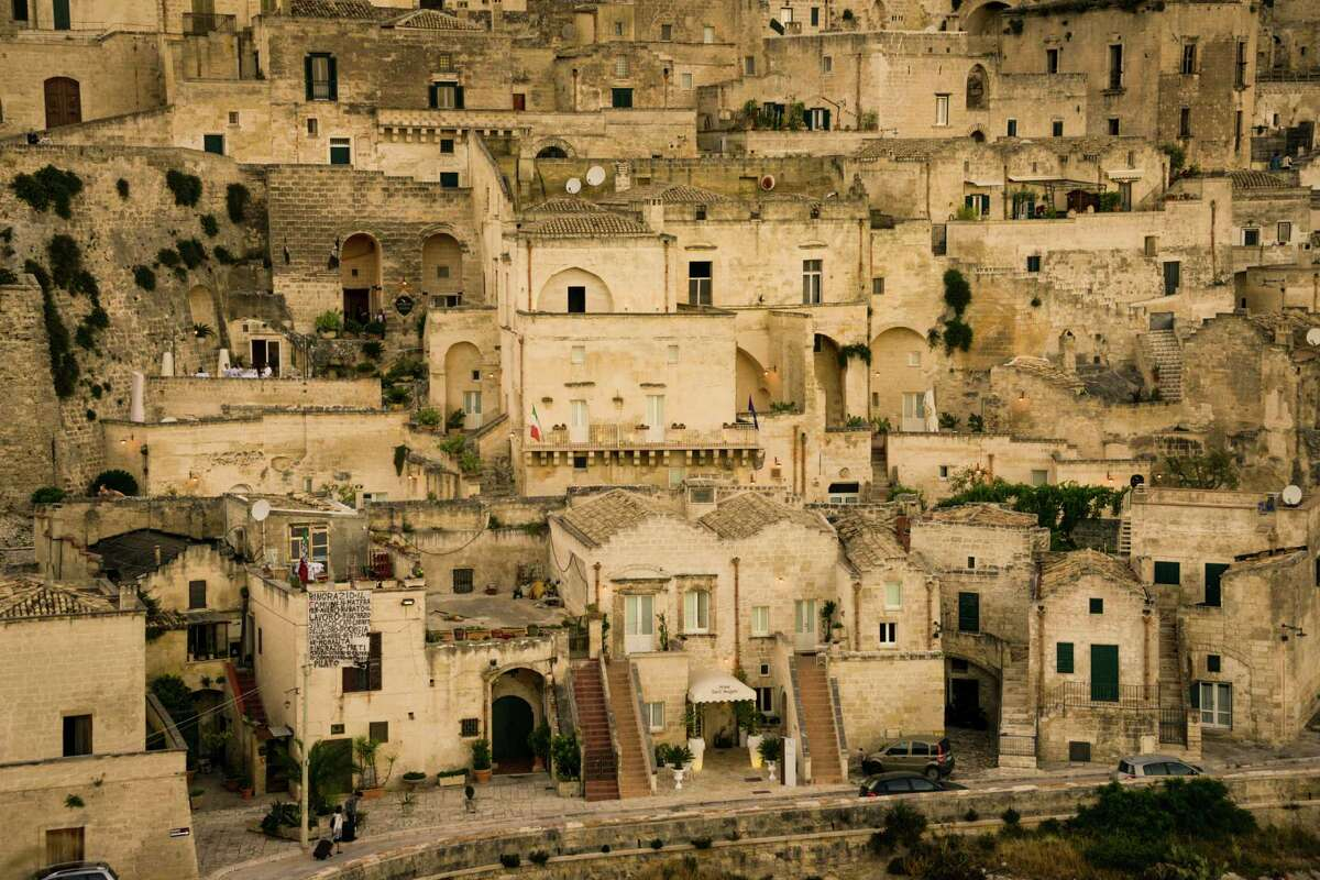 With homes carved into the side of a ravine, Matera has been occupied since the Paleolithic period.
