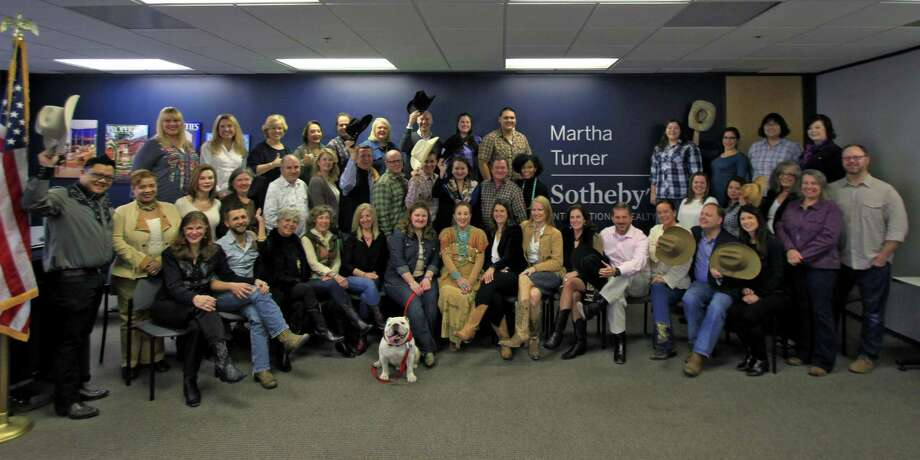 More than 60 agents, management and staff joined founder and co-president Martha Turner in the company's meeting room at 50 Briar Hollow Lane to celebrate all things Texan in a relaxed social setting. Photo: Courtesy Of Martha Turner Sotheby's International Realty