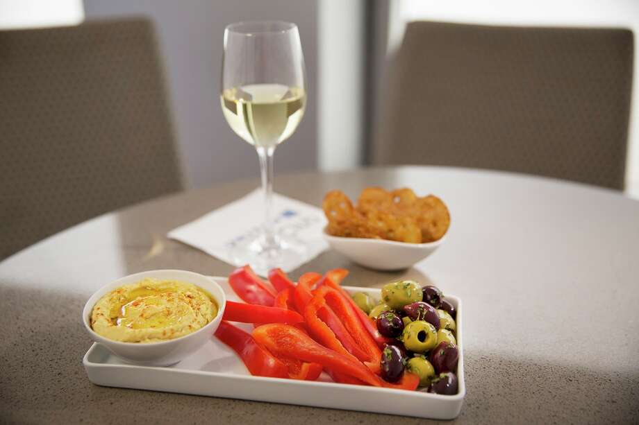 New healthier complimentary food offerings in United Airlines' United Club airport lounges will include a Greek yogurt bar, hot oatmeal station, salads, soups and hummus. The new menu should be available at United Clubs in IAH by the end of summer 2015. Photo: Wayne Slezak / United Airlines