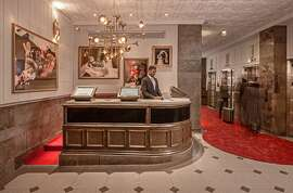 The hotel is located in Chicago's historic Old Dearborn Bank Building. The front desk is the original 1920s Cigar Bar.