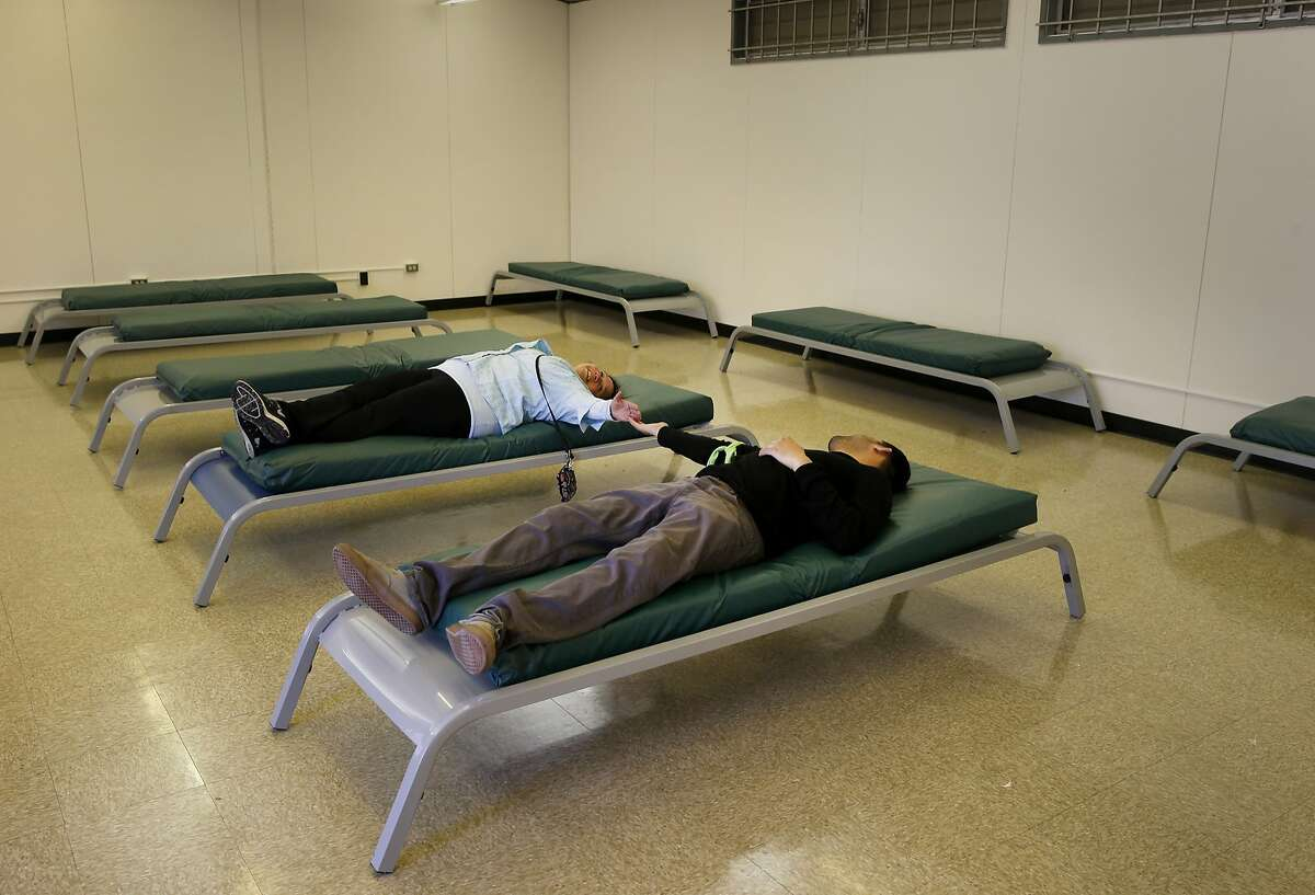 """Two shelter workers checked out the beds in one building of the navigation center Thursday March 5, 2015. San Francisco's new """"navigation center"""" was unveiled to the public on Mission Street, a facility that will move entire encampments from the street and get them into permanent housing."""