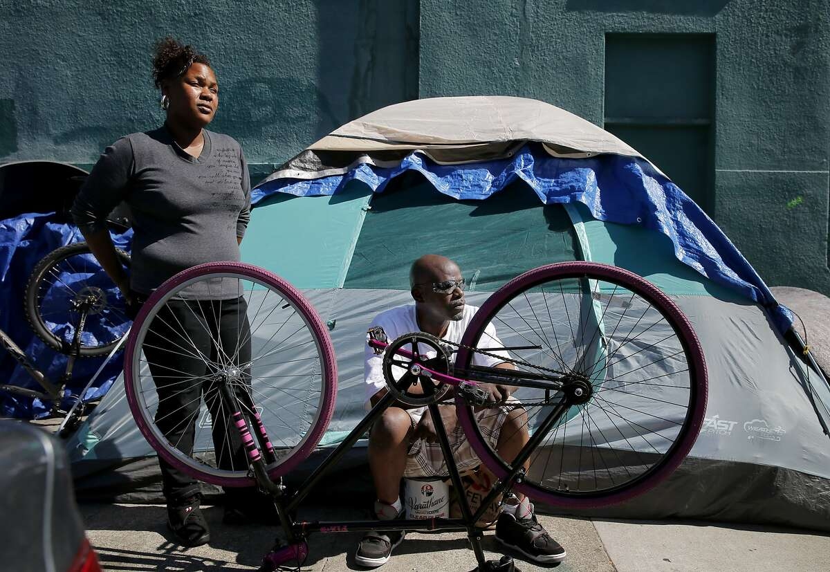 """Roz Barnett (left) and Gregory Fairrer have heard of the new navigation center and hope it will save them from their encampment a few blocks away on Shotwell Street. San Francisco's new """"navigation center"""" was unveiled to the public on Mission Street, a facility that will move entire encampments from the street and get them into permanent housing."""