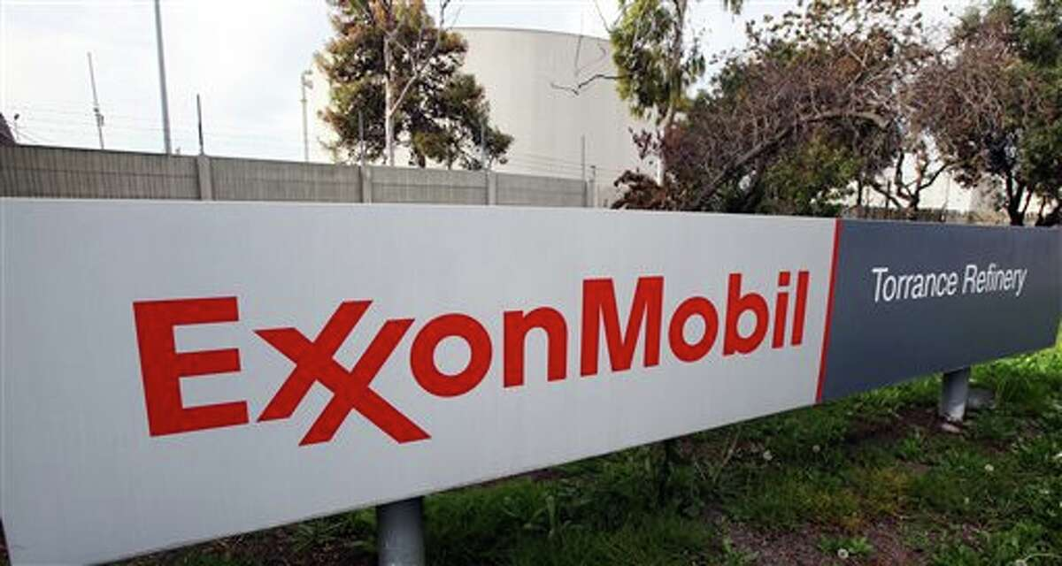 FILE - This Jan. 30, 2012, file photo, shows the sign for the ExxonMobil Torerance Refinery in Torrance, Calif. Exxon Mobile on Monday, Feb. 2, 2015, reported fourth-quarter earnings of $6.57 billion. (AP Photo/Reed Saxon, File)