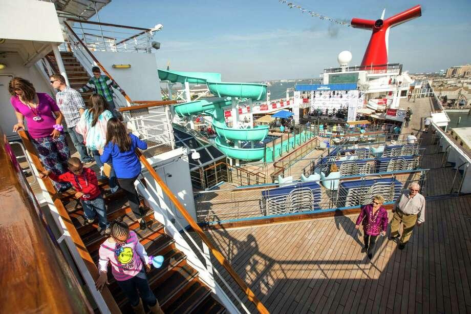 Passengers explore the deck of the Carnival Freedom. Photo: Brett Coomer, Staff / © 2015 Houston Chronicle