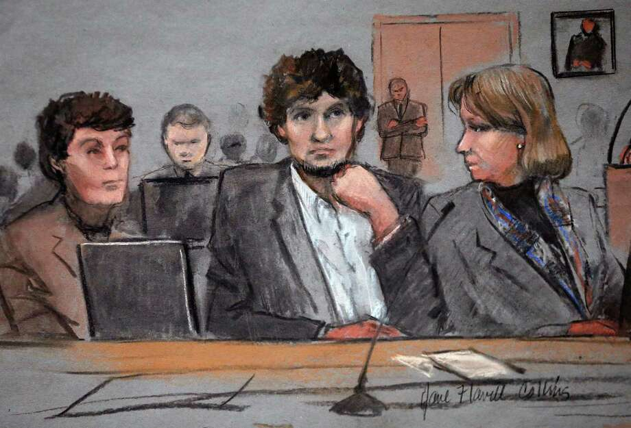 Dzhokhar Tsarnaev, center, is depicted between defense attorneys Miriam Conrad, left, and Judy Clarke during his federal death penalty trial last week. Photo: Jane Flavell Collins, FRE / Jane Flavell Collins