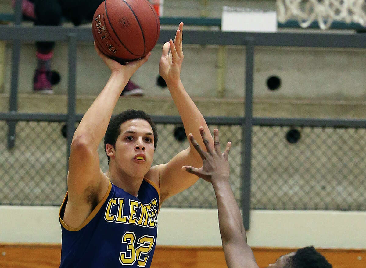 Cayne Edwards takes an outside shot for Clemens over Toby Osidele of Brennan at Taylor Field House on Dec. 20, 2014.