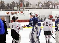 Bryan Archino, of Greenwich, left, and Will Massie, of Darien, center, two of the region's best high school goaltenders, shake hands at the Dorothy Hamill Rink in Greenwich on Feb. 3 after their game ended in a 3-3 tie. At right is Kevin Piotrzkowski of Greenwich. Greenwich and Darien meet again Saturday in the FCIAC tournament finals.