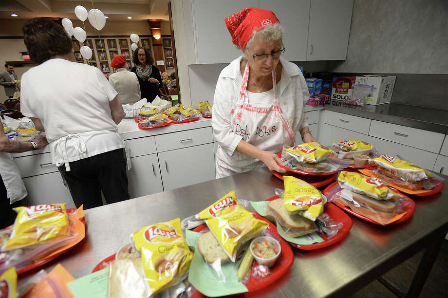Rita Davis preps sandwiches during Thursday's Deli-Day at Temple Emanuel in Beaumont. The fundraiser offered around 2,000 turkey and corn beef sandwiches, chips and a pickle.  Photo taken Thursday, March 06, 2015 Guiseppe Barranco/The Enterprise Photo: Guiseppe Barranco, Photo Editor