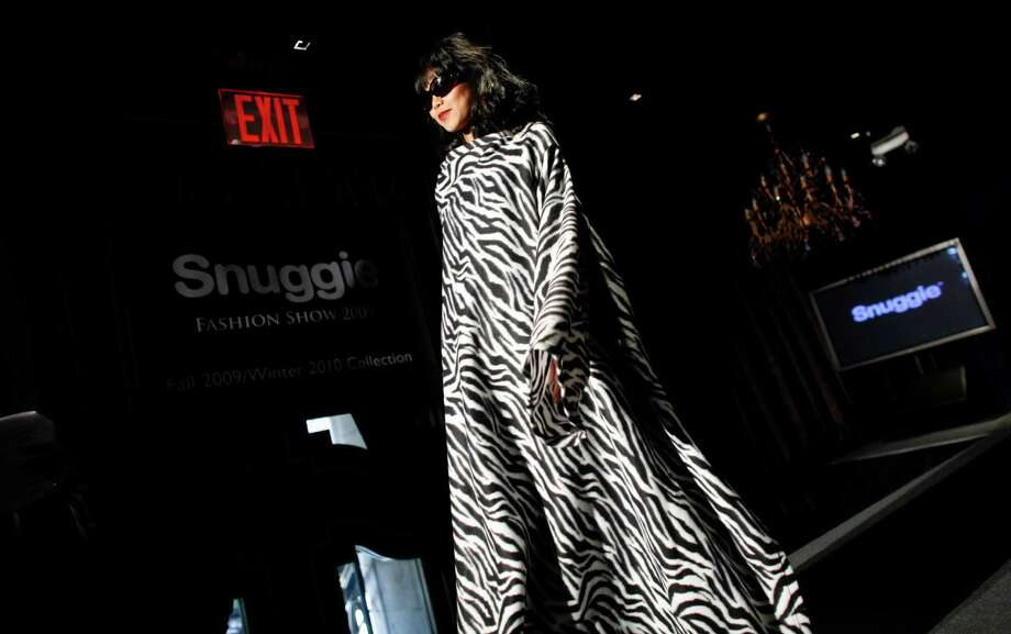 A sleeved blanket was modeled during a 2009 Snuggie show in New York. Allstar Marketing Group, the company behind the Snuggie, has settled a case with the Federal Trade Commission.  Photo: Jason DeCrow, FRE / FR103966 AP