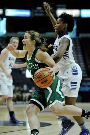 Jacqui Thompson of Manhattan, left, drives to the basket past Taylor McKay of Niagara during their MAAC Tournament game at the Times Union Center on Thursday, March 5, 2015, in Albany, N.Y.   (Paul Buckowski / Times Union) Photo: PAUL BUCKOWSKI / 10030862A