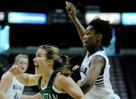 Jacqui Thompson of Manhattan, left, drives to the basket past Taylor McKay of Niagara during their MAAC Tournament game at the Times Union Center on Thursday, March 5, 2015, in Albany, N.Y.   (Paul Buckowski / Times Union)