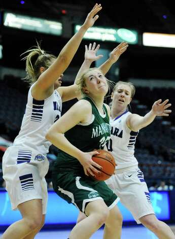 Victoria Rampado of Niagara, left, and Kelly Van Leeuwen of Niagara, right, defend as Kayla Grimme of Manhattan tries to get a shot off during their MAAC Tournament game at the Times Union Center on Thursday, March 5, 2015, in Albany, N.Y.   (Paul Buckowski / Times Union) Photo: PAUL BUCKOWSKI / 10030862A