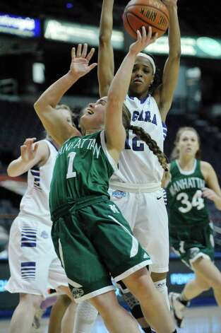 Jacqui Thompson of Manhattan, left, puts up a shot as Taylor McKay of Niagara, right, defends during their MAAC Tournament game at the Times Union Center on Thursday, March 5, 2015, in Albany, N.Y.   (Paul Buckowski / Times Union) Photo: PAUL BUCKOWSKI / 10030862A