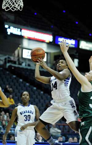 Sylvia Maxwell of Niagara puts up a shot as she drives past Manhattan players during their MAAC Tournament game at the Times Union Center on Thursday, March 5, 2015, in Albany, N.Y.   (Paul Buckowski / Times Union) Photo: PAUL BUCKOWSKI / 10030862A