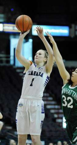 Meghan McGuinness of Niagara puts up a shot over Manhattan players during their MAAC Tournament game at the Times Union Center on Thursday, March 5, 2015, in Albany, N.Y.   (Paul Buckowski / Times Union) Photo: PAUL BUCKOWSKI / 10030862A