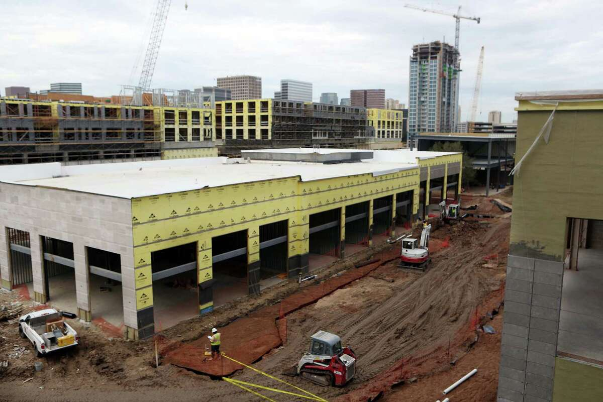 The new River Oaks District development is expected to be completed by Fall 2015 on Wednesday, Dec. 10, 2014, in Houston. The development will have shops, restaurants, a cinema, offices and residential units. ( Mayra Beltran / Houston Chronicle )