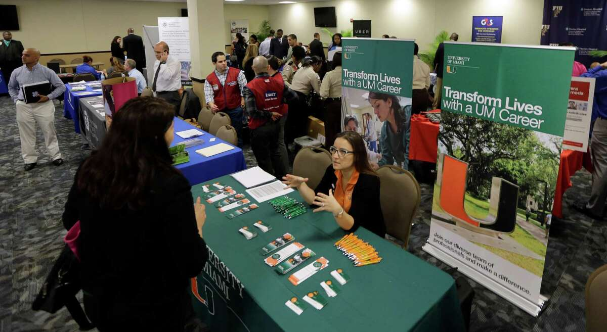 In this photo taken Friday, Feb. 6, 2015, U.S. Armed Forces Veterans attend the annual Veterans Career and Resource Fair in Miami. The Labor Department releases weekly jobless claims for the week ending Feb. 28 on Thursday, March 5, 2015. (AP Photo/Alan Diaz) ORG XMIT: NYBZ109