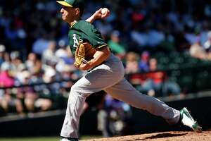 A's switch pitcher Pat Venditte impresses again - Photo