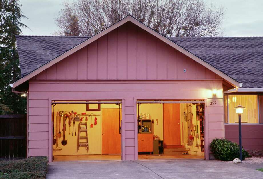 Organizing the garage can save time by making tools and other items easy to find. Cleaning up can also make room for a car. Photo: Getty Images / (c) Patti McConville