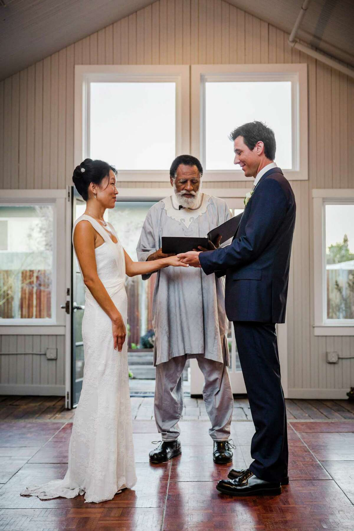 Arnold Perkins, Community Servant, officiated the wedding ceremony of Phuong Quach and Brian Thoms in Vessel Gallery in Oakland.