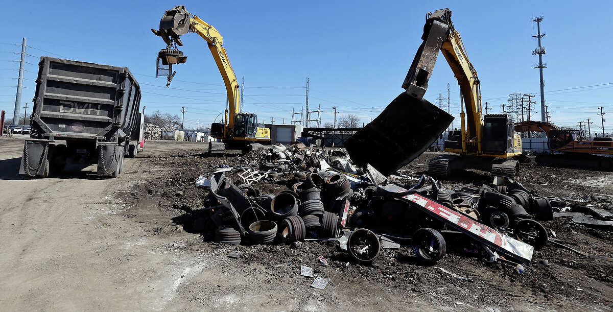 Recyclable scrap metal is sorted at Texas Auto Salvage.