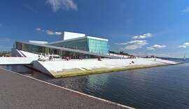 Oslo's striking Opera House, which opened in 2008, rises out of the water, its white-marble roof famously sloping into the fjord, creating a public plaza.