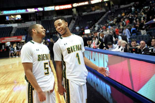 Siena's Evan Hymes, left, and Marquis Wright celebrate their 71-54 win over Niagara in their first round game in the MAAC Championship on Thursday, March 5, 2015, at Times Union Center in Albany, N.Y. (Cindy Schultz / Times Union) Photo: Cindy Schultz / 10030857A