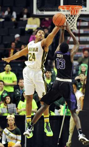 Siena's Lavon Long, left, knocks the ball away from Niagara's Matt Scott during their first round game in the MAAC Championship on Thursday, March 5, 2015, at Times Union Center in Albany, N.Y. (Cindy Schultz / Times Union) Photo: Cindy Schultz / 10030857A