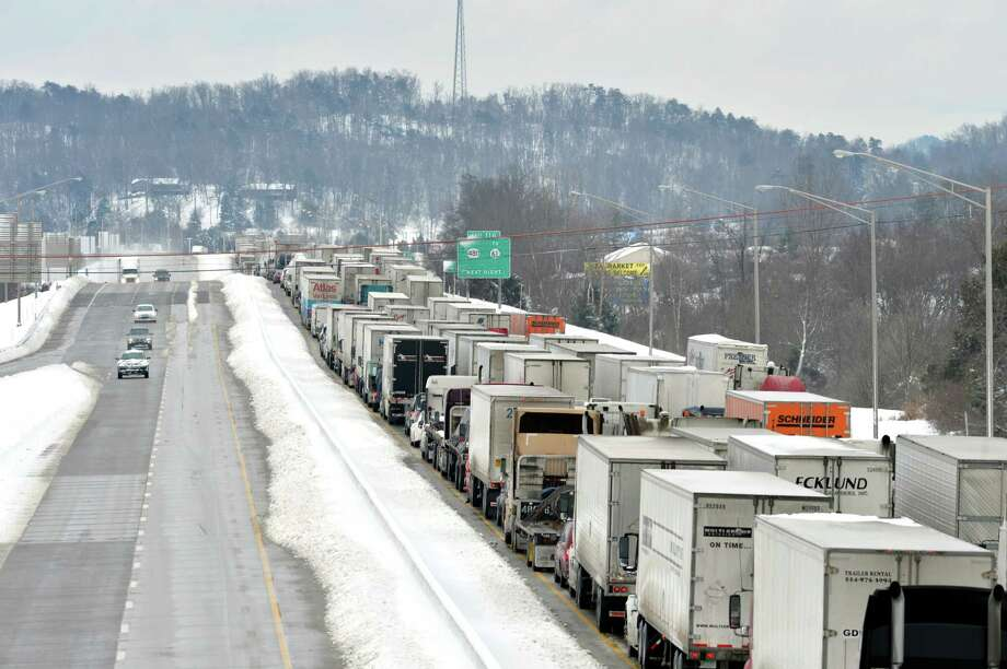 More than 50 miles of Interstate 65 southbound in Kentucky is shut down from the weather, Thursday, March 5, 2015, in Mt. Washington, Ky. Kentucky State Police has reported that the interstate will not reopen for 6-8 hours. Kentucky has been walloped by a winter storm that has dumped nearly two feet of snow in parts of the Bluegrass state. (AP Photo/Timothy D. Easley) Photo: Timothy D. Easley, FRE / FR43398 AP