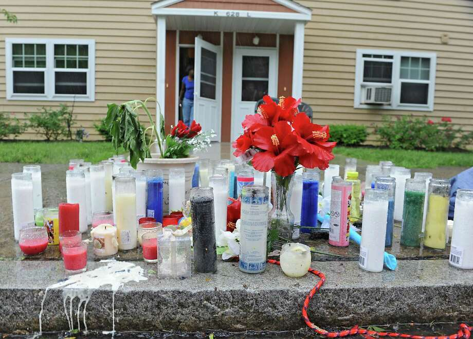Roadside memorial at 628 South Pearl St. for Qazir Sutherland, 7-year-old boy who died yesterday after being struck by a car here on Saturday night,  Monday, June 17, 2013 in Albany, N.Y.  (Lori Van Buren / Times Union) ORG XMIT: MER2015030511514291 Photo: Lori Van Buren / 10022854A