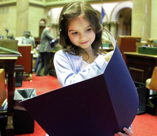 Six-year-old Emma Detlefsen of Berne reads an Assembly Resolution honoring her in the Assembly Chamber Wednesday March 4, 2015 in Albany, NY.  (John Carl D'Annibale / Times Union) Photo: John Carl D'Annibale / 10030864A