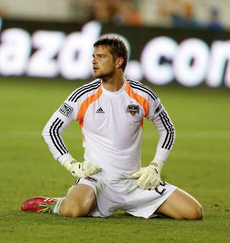 Houston Dynamo goalkeeper Tyler Deric (24) sits on the turf after Sporting KC scored a goal during the first half of the MLS soccer game at BBVA Compass Stadium, Friday, June 6, 2014, in Houston.  ( Karen Warren / Houston Chronicle  ) Photo: Karen Warren, Staff / © 2014 Houston Chronicle