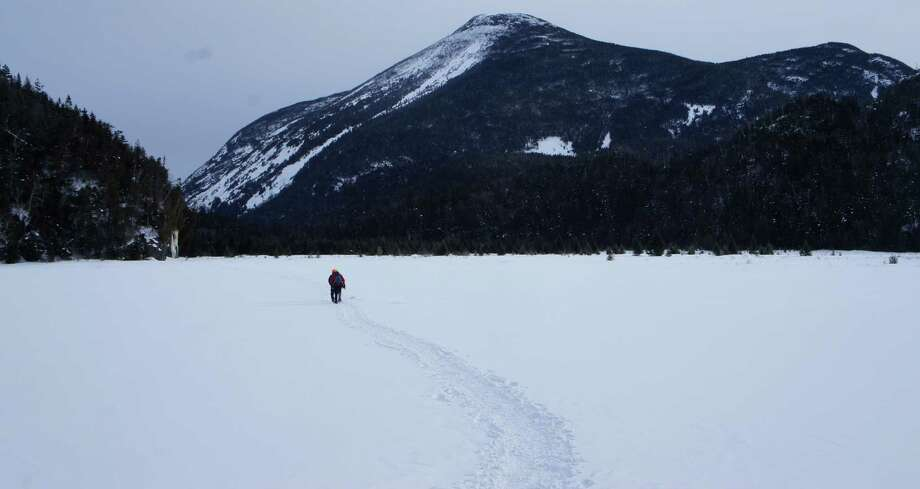 Two hikers cross the Flowed Lands in front of Mount Colden. (Herb Terns / Times Union file photo) Photo: Picasa