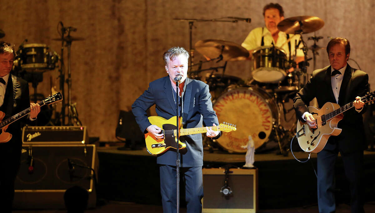 John Mellencamp (center) performs Thursday March 5, 2015 at the Tobin Center for the Performing Arts.