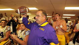 John Chavis, shown receiving a game ball in the LSU locker room in 2011, is excited about his new job as defensive coordinator at Texas A&M.