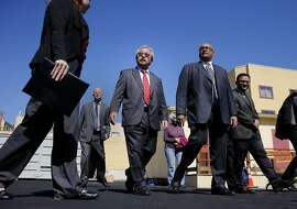 "Mayor Ed Lee (center with red tie) toured the new facility with other civic leaders Thursday March 5, 2015. San Francisco's new ""navigation center"" was unveiled to the public on Mission Street, a facility that will move entire encampments from the street and get them into permanent housing."