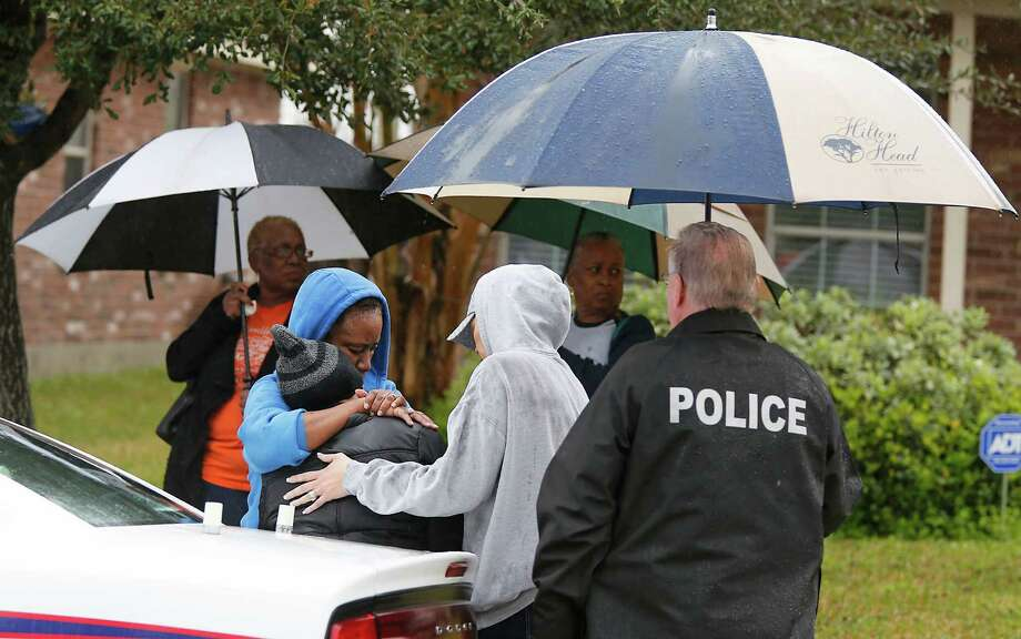 The mother, third from left, of a 4-year-old boy who died in an accidental shooting is comforted. Three children were shot in three days in the Houston area. Photo: James Nielsen, Staff / © 2015  Houston Chronicle