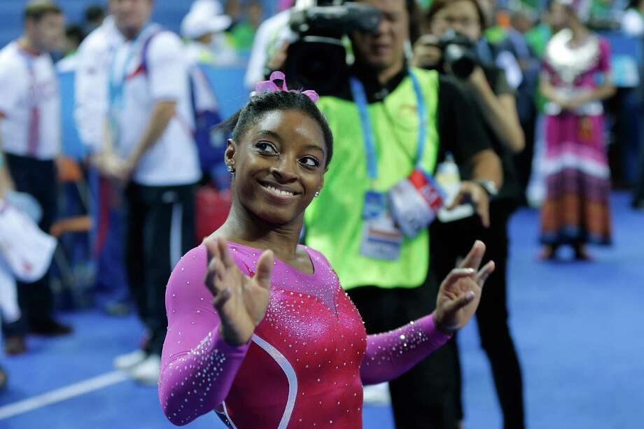 Spring's Simone Biles, a two-time world champion, is trying to get her bearings in massive AT&T Stadium for this weekend's American Cup. Photo: Lintao Zhang, Staff / 2014 Getty Images