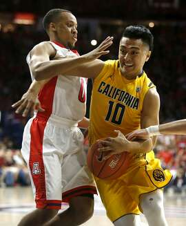 California guard Brandon Chauca (10) drives on Arizona guard Parker Jackson-Cartwright during the first half of an NCAA college basketball game, Thursday, March 5, 2015, in Tucson, Ariz. (AP Photo/Rick Scuteri)
