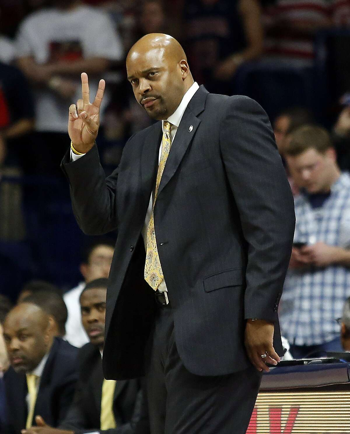 California head coach Cuonzo Martin calls out a play against Arizona during the first half of an NCAA college basketball game, Thursday, March 5, 2015, in Tucson, Ariz. (AP Photo/Rick Scuteri)