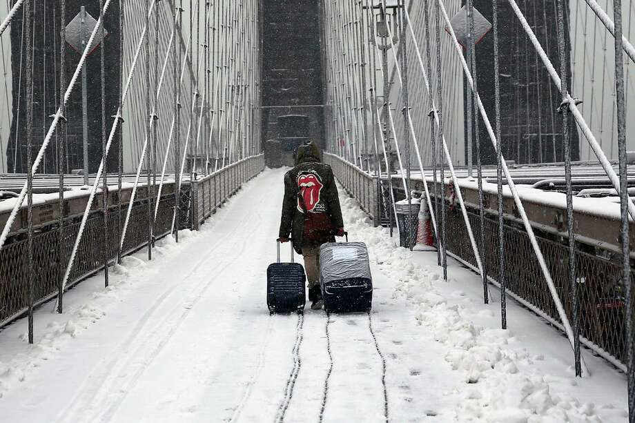 Winter weather that frosted New York's Brooklyn Bridge bit into natural gas inventories as Americans cranked up gas-fired furnaces. Natural gas in storage fell by 228 billion cubic feet in the week ending Feb. 27. Photo: Spencer Platt, Staff / 2015 Getty Images